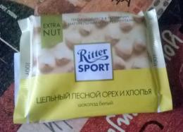 """Шоколад белый Ritter sport с начинкой """"Цельный лесной орех и хлопья"""""""