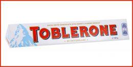 Швейцарский белый шоколад Toblerone с медово-миндальной нугой