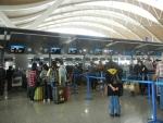 Аэропорт Пудун в Шанхае - стойки регистрации на рейс