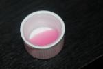 Суспензия розового цвета.