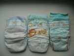 слева направо: Pampers Premium Care, Pampers Active Baby, Pampers Sleep and Play.