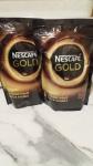 Упаковки с Nescafe Gold кофе.