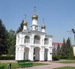 Часы на воротах  у Часовни в честь Рождества Христова (Россия, Тольятти)
