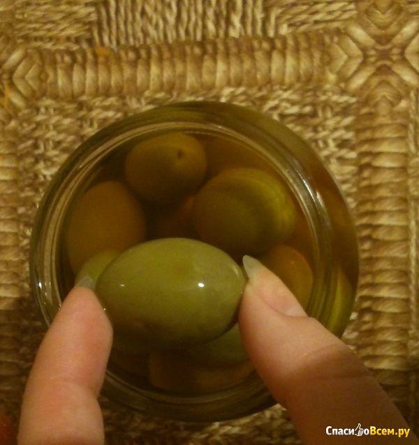 Зеленые оливки Kalimera с косточками легко маринованные в морской соли фото