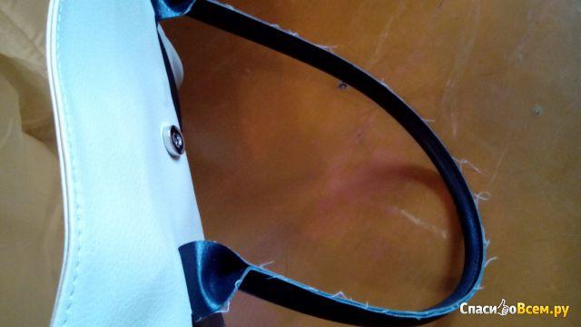 Элегантная сумка бежевого и темно-коричневого цвета Yves Rocher фото