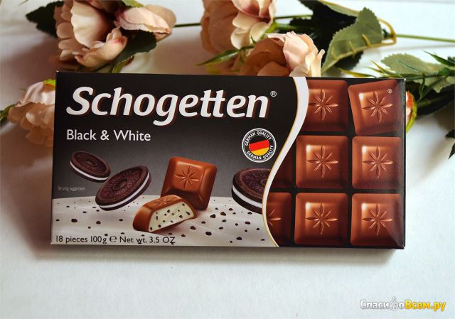 """Шоколад молочный Schogetten """"Black & White"""" с начинкой """"ванильный крем"""" с кусочками печенья с какао фото"""