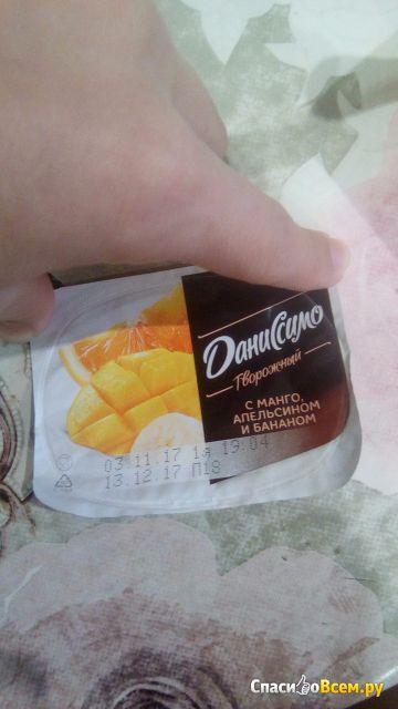 Продукт творожный с манго, апельсином и бананом Danone Даниссимо 5,4% фото
