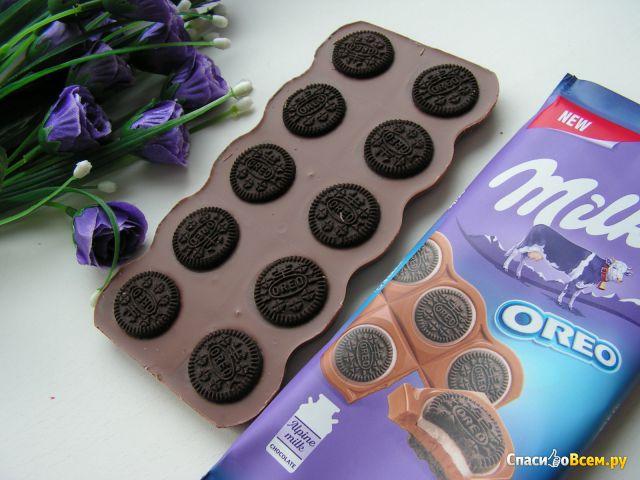 """Шоколад молочный """"Milka"""" с круглым печеньем Oreo со вкусом ванили фото"""