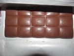 Молочный шоколад Milka с клубникой и сливками